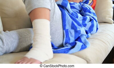 Child  with bandage on leg, laying