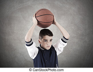 child with basketball on background