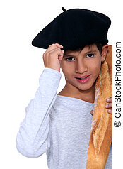 Child with beret and loaves of bread