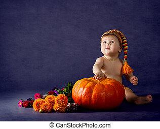 Child with big pumpkin