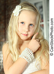 Child with blond hair - beautiful young girl close-up