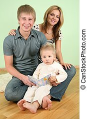 child with book and parents 2