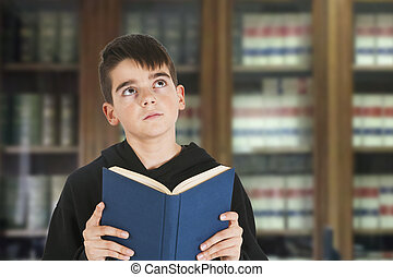 Child with books in the library