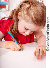Child with brush draw picture  in play room.