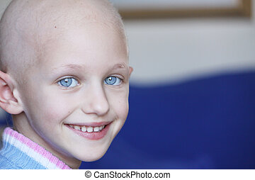 a young caucasian child suffering hair loss due to the effects of chemotherapy used to fight cancer