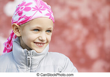 child with cancer - beautiful caucasian girl wearing a head...