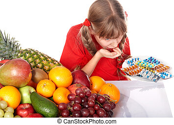 Child with capsule and fruit. - Little girl with capsule and...