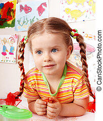 Child with chalk draw in playroom. - Child with piece of...