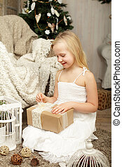Child with Christmas gift at home