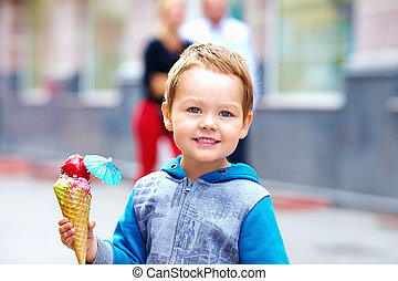 child with colorful ice cream outdoors