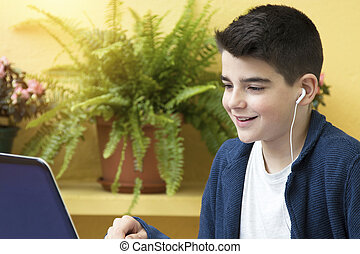 child with computer and headphones