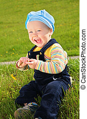 child with dandelion on meadow
