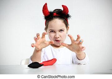 child with devil horns