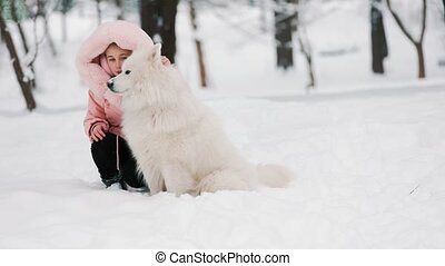 child with dog in the park