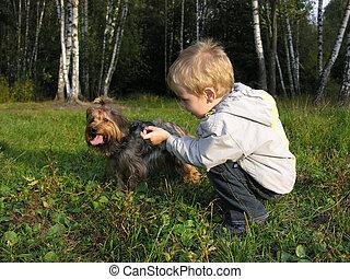 child with dog sundown wood