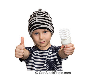 Child with energy saving lamp