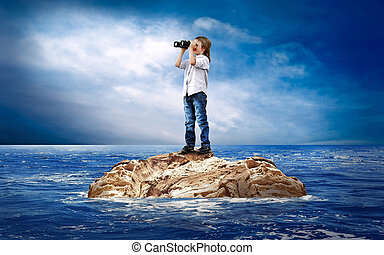 Child with eyesglass on the island in sea.