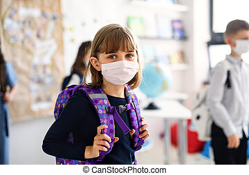 Child with face mask going back to school after covid-19 ...