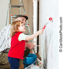 child  with father paints wall