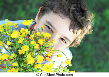 child with field flowers