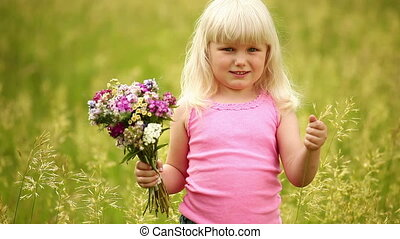 Child with flowers in the park.