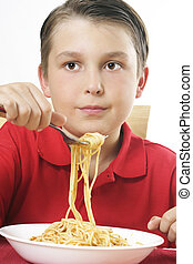 Child with forkful of noodles
