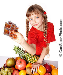 Child with fruit and vitamin pill. Isolated.
