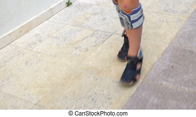 Child with functional electrical stimulation making his way
