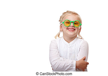Child with glasses is smiling happy