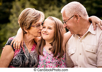 Child with grandparents