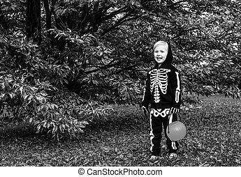 child with Halloween pumpkin Jack O'Lantern basket