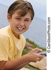 Child with handheld game