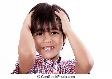 child with hands on head