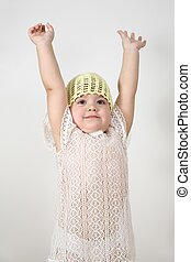 child with hands up