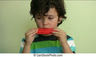 Child with harmonica