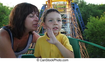 child with her mother on the Ferris wheel