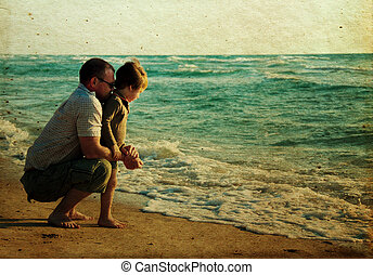 child with his father at sea. Photo in old color image style...