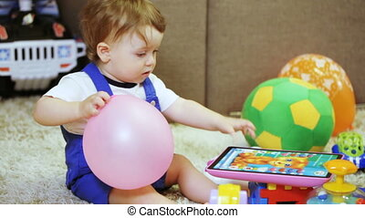 Child with his mother at home with toys