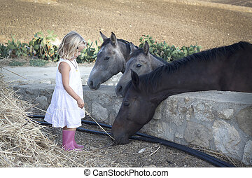 CHild with horses
