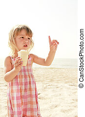 Child with ice-cream on the sea