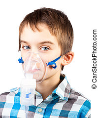 Child with inhaler mask - Portrait of cute boy using...