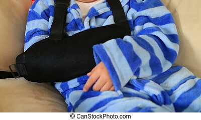 Child  with injured arm and bandage