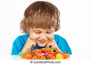 Child with jelly candies on white background