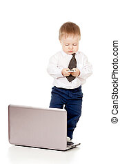 Child with laptop and mobile phone