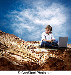 Child with laptop on the mauntain under sky with clouds