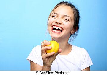 Child with lemon