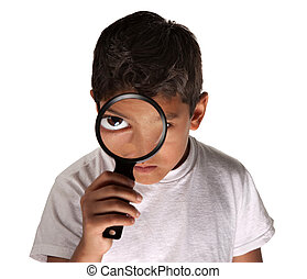 Child with Magnifying Glass - Young Latino boy looking...