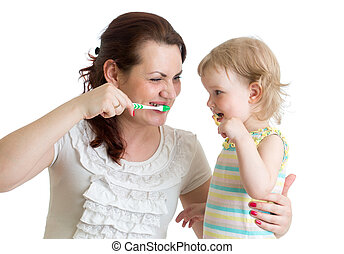 child with mom brushing teeth