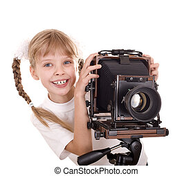 Child with old large format digital camera.