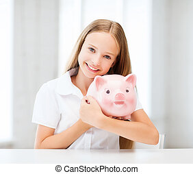child with piggy bank - education, school and money saving...